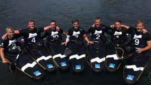 Herrenmannschaft des KCNW Berlin in Booten